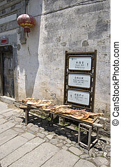 drying meat and sign