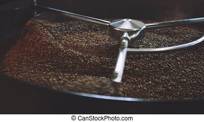 Drying Roasted Coffee Beans - Close up view of mixing...