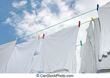 Drying - White clothes drying on the rope