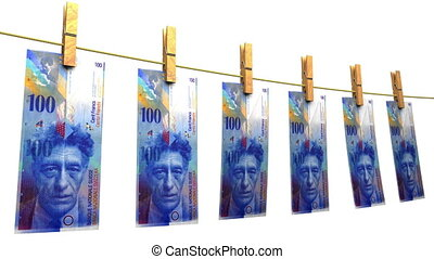 Drying Swiss Francs (Loop Matte) - Hanging 100 CHF bills....