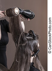 Drying woman's hair