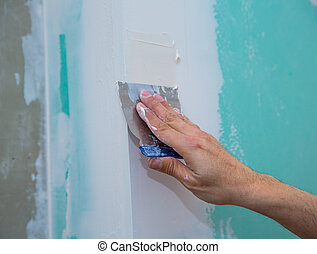 drywall hydrophobic plasterboard in green plastering seam with trowel