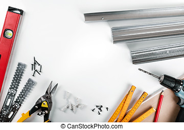 drywall mounting tools and fasteners on white background. top view
