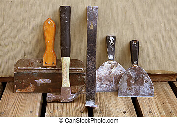 Drywall Tools - Still life of various tools to remove and...