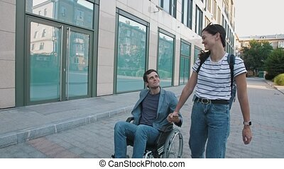 Dsabled person in a wheelchair with a girlfriend