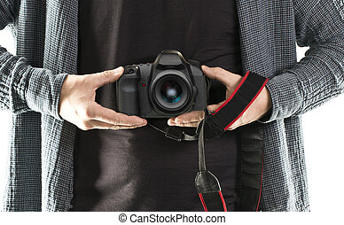 DSLR camera holding in a hand
