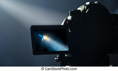 DSLR camera making video in studio.