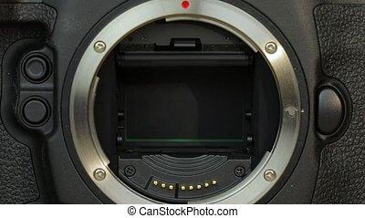 DSLR camera mirror, shutter and sensor closeup
