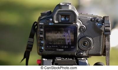 DSLR camera on tripod shooting chair