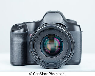 DSLR photo camera. Over grey background