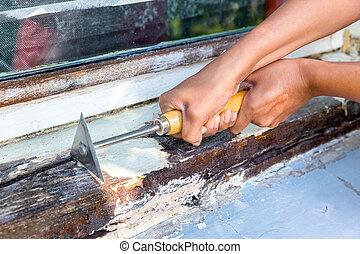 duas mãos, trabalhando, com, pinte raspador