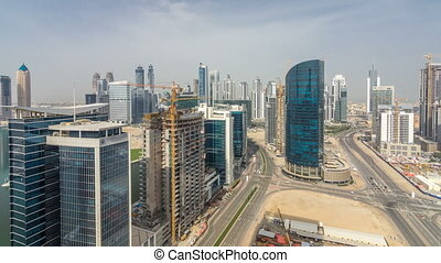 Dubai business bay towers at day time aerial timelapse.
