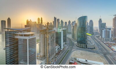 Dubai business bay towers at sunset aerial timelapse....