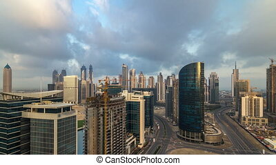 Dubai business bay towers early morning aerial timelapse....