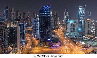 Dubai business bay towers night timelapse aerial - Dubai...