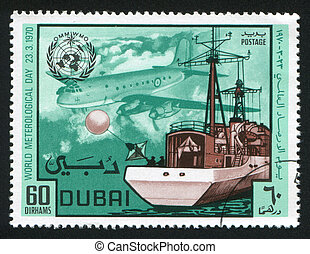 Ship and Airplane - DUBAI - CIRCA 1970: stamp printed by ...