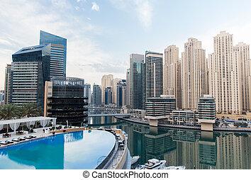 Dubai city seafront with hotel infinity edge pool