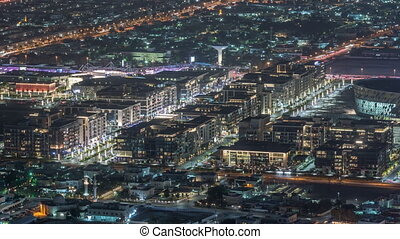 Dubai City Walk aerial night timelapse, travel and leisure venue in Dubai downtown with many cafes and restaurants and an outdoor retail complex