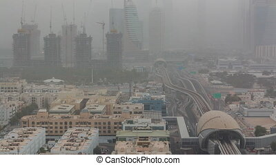 Dubai cityscape during sand storm timelapse, aerial view of...