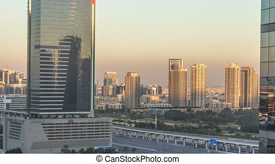 Dubai cityscape showing al barsha area at sunset timelapse...