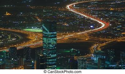 Dubai cityscape traffic night time lapse. pan up