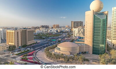 Dubai Creek area surrounded by modern buildings and busy...