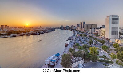 Dubai creek landscape at sunset timelapse with boats and...