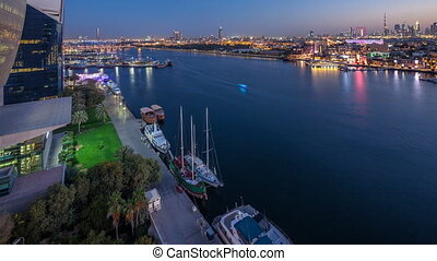 Dubai creek landscape day to night timelapse with boats and...