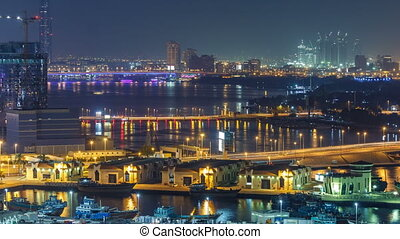Dubai creek landscape night timelapse with boats and ship...