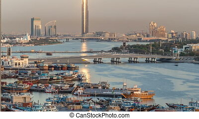 Dubai creek landscape timelapse with boats and ship in port...