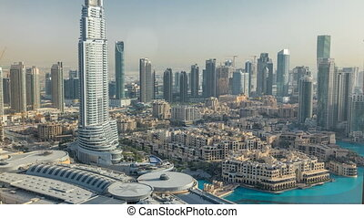 Dubai downtown during sunset timelapse. Top view from above