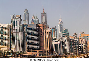 DUBAI, UAE - NOVEMBER 13: Modern skyscrapers in Dubai (emirate and city), UAE. Dubai now boasts more completed skyscrapers higher than 0,8 - 0,25 km than any other city on 13 November 2012 in Dubai.