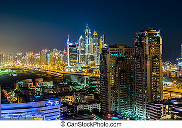 DUBAI, UAE - NOVEMBER 13: Modern skyscrapers in Dubai (emirate and city), UAE. Dubai now boasts more completed skyscrapers higher than 0,8 - 0,25 km than any other city, taken on 13 November 2012 in Dubai.