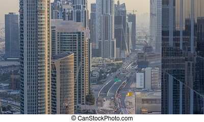Dubai Downtown evening timelapse modern towers view from the...