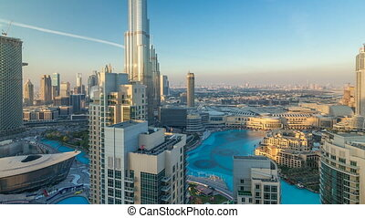Dubai downtown in the evening timelapse in bright yellow sunset light