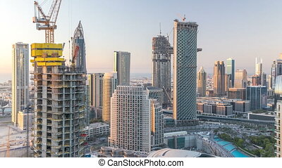 Dubai downtown in the evening timelapse in bright yellow...