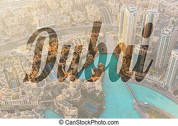 Dubai downtown morning scene - Name of city Dubai written on...