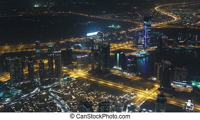 Dubai downtown night scene with city lights from Burj Khalifa timelapse