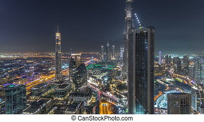 Dubai Downtown night timelapse modern towers panoramic view...