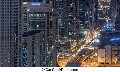 Dubai Downtown night timelapse modern towers view from the...