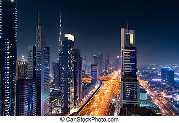 Dubai downtown night view with modern skyscrapers