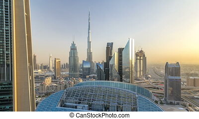 Dubai downtown skyline at sunset timelapse with tallest...