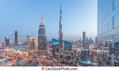 Dubai downtown skyline day to night timelapse with tallest...