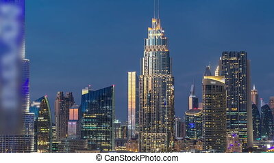 Dubai Downtown skyline day to night timelapse with towers paniramic view from the top in Dubai