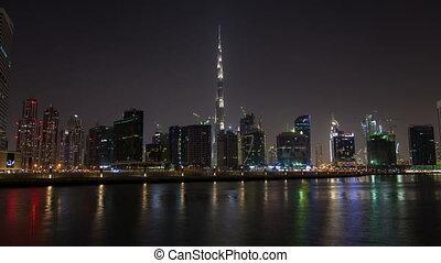 Dubai downtown skyline night time lapse. pan up