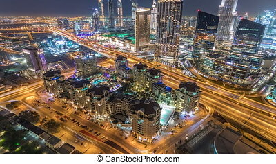 Dubai downtown skyline night timelapse with mall and road...