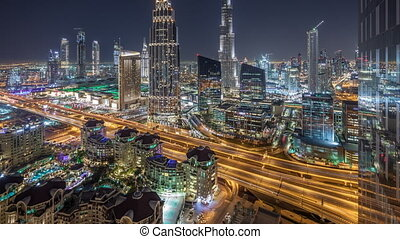 Dubai downtown skyline night timelapse with tallest building...