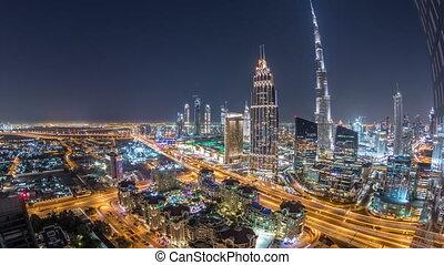 Dubai downtown skyline night timelapse with tallest building...