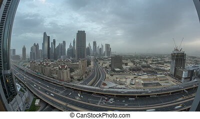 Dubai downtown skyline night to day aerial timelapse with traffic on highway