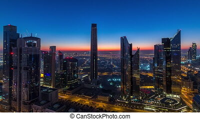 Dubai downtown skyline with tallest skyscrapers and traffic on highway night to day timelapse